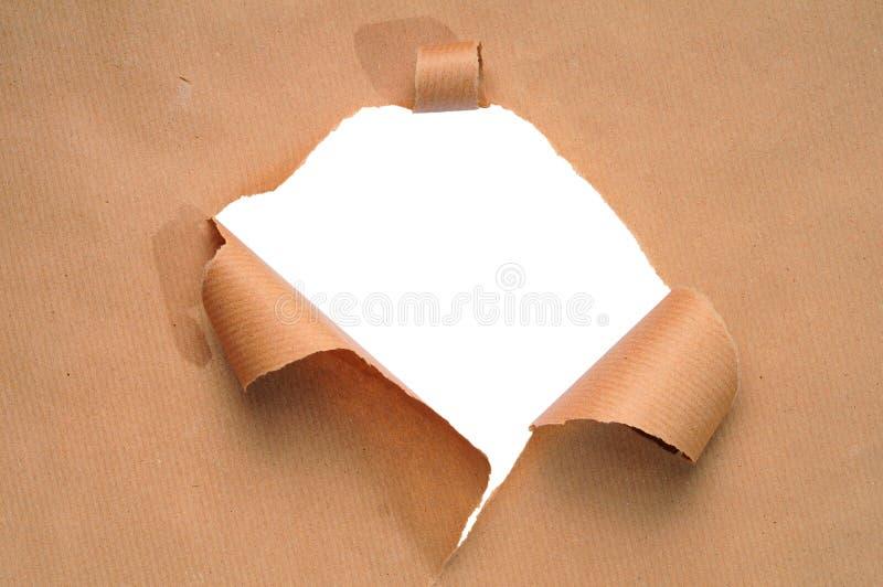 Trou dans un papier image stock