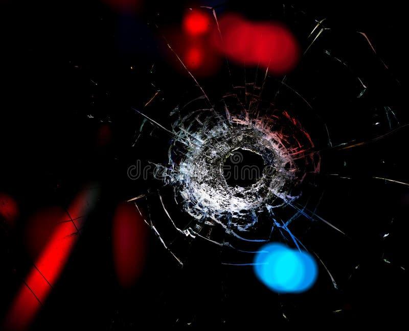 Trou de balle dans le verre. image libre de droits