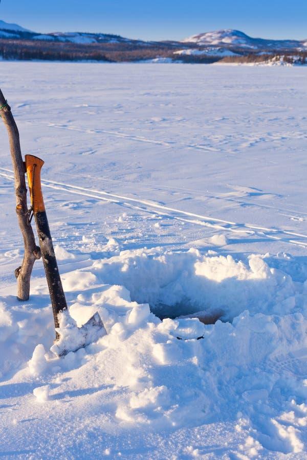 trou de Glace-pêche photographie stock libre de droits