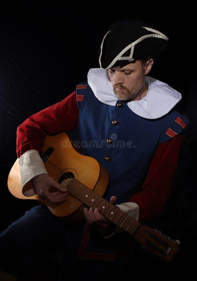 troubadour человека гитары стоковые изображения rf