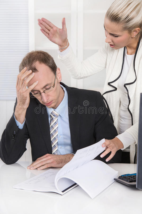 Trouble and harassment under business colleagues: bullying man a. Trouble and harassment under business colleagues: bullying and gossip men and woman royalty free stock images