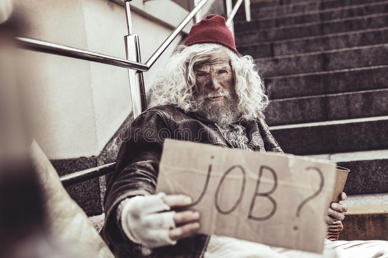 Troubled almsman asking stranger about any job for him. stock image