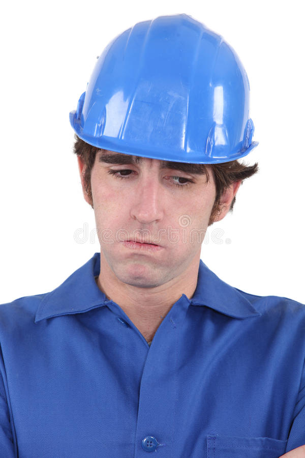 Troubled construction worker royalty free stock photography
