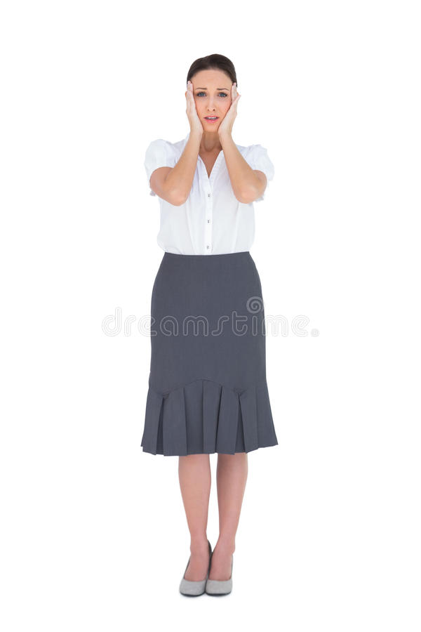 Troubled gorgeous businesswoman posing stock photography