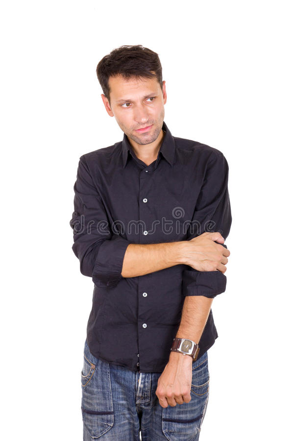 Troubled sad man standing lonely with hand on elbow stock images