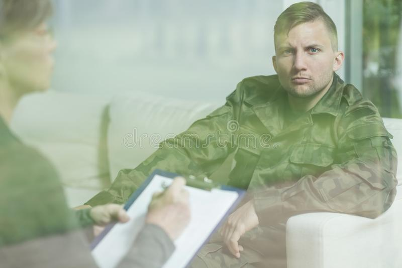 Troubled soldier during psychotherapy session royalty free stock photos