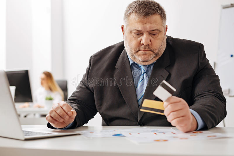 Troubled white collar worker running out of money stock images
