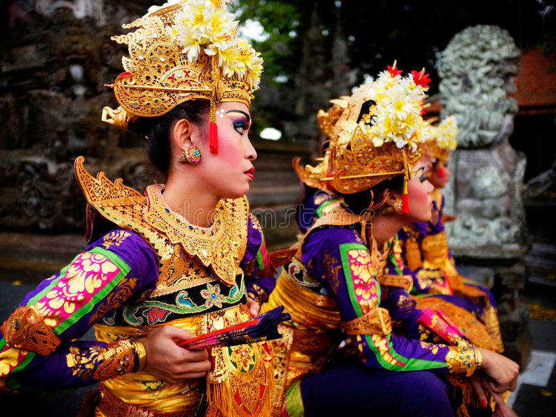 A troupe of Balinese dancers rest during an evening dance performance in Ubud, Bali royalty free stock photography