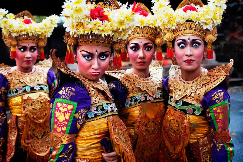 A troupe of female Balinese dancers rest during an evening dance performance in Ubud, Bali royalty free stock photos
