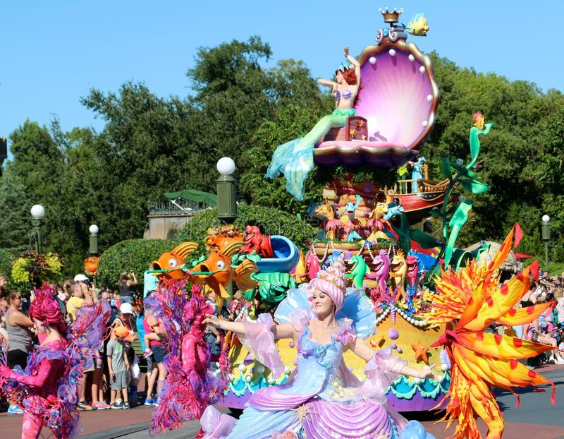 Troupe of performers at Disneyworld. Disney characters perform in a street parade at Disney's Magic Kingdom stock photos