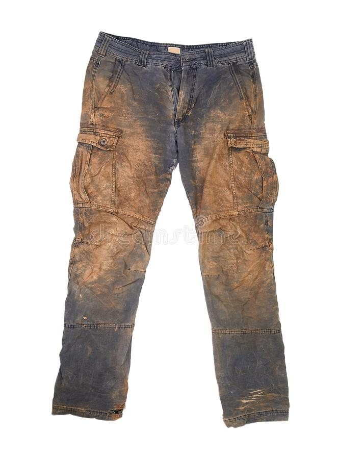 Trousers with mud. Torn and dirty working trousers covered in mud and clay royalty free stock image
