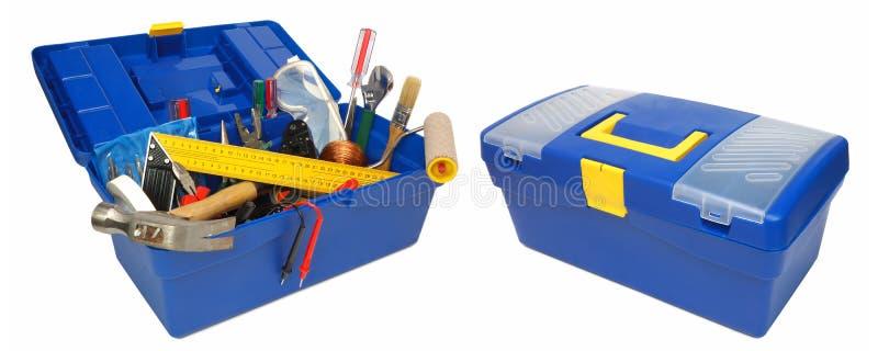 Trousse à outils dans la boîte bleue D'isolement sur le blanc photographie stock