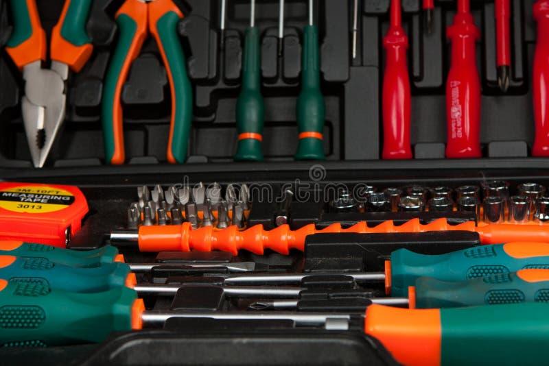 Trousse à outils dans la boîte noire photographie stock