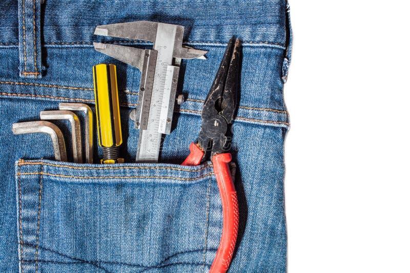 trousse à outils dans la poche de treillis photographie stock libre de droits
