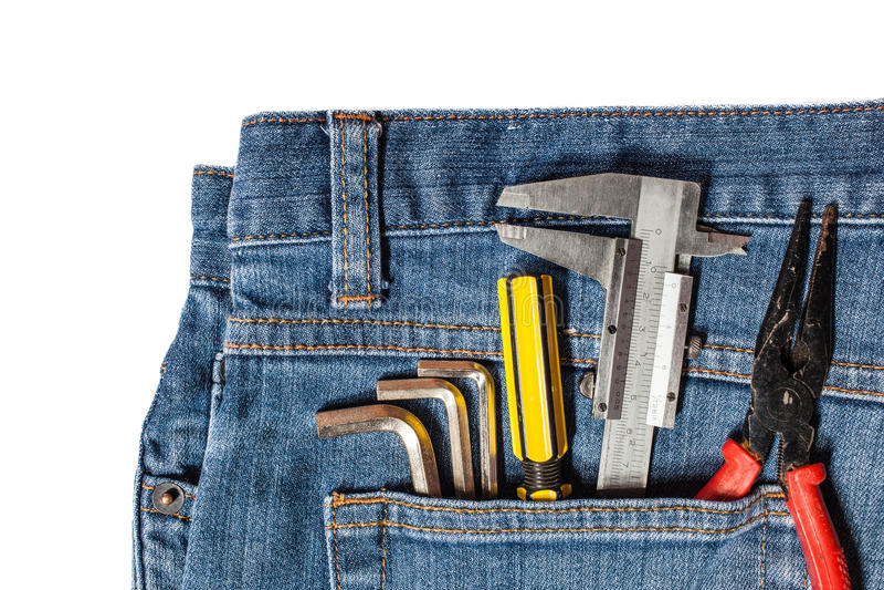 trousse à outils dans la poche de treillis image libre de droits