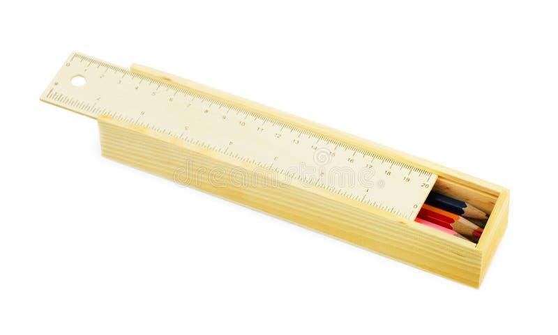 Trousse d'écolier avec des crayons de couleur photos stock
