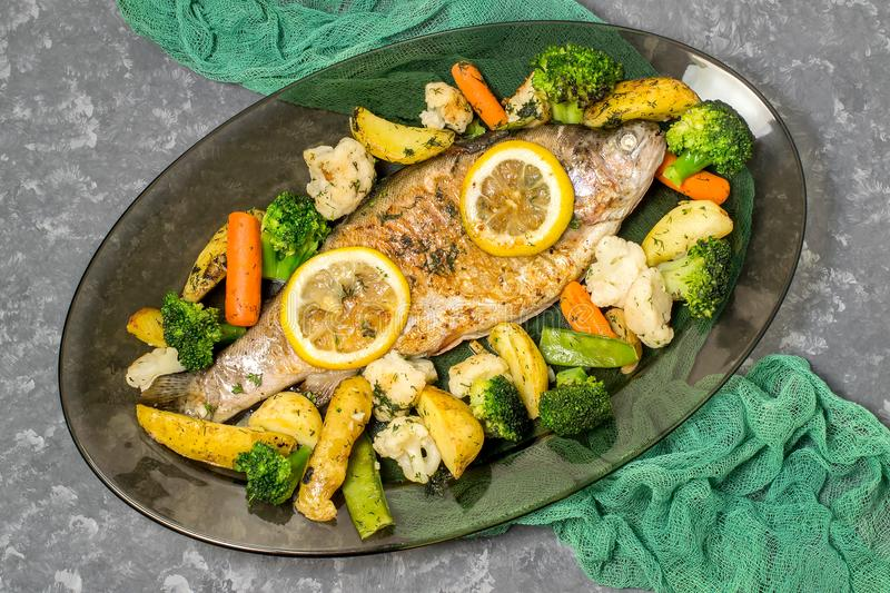Trout baked with vegetables royalty free stock photo