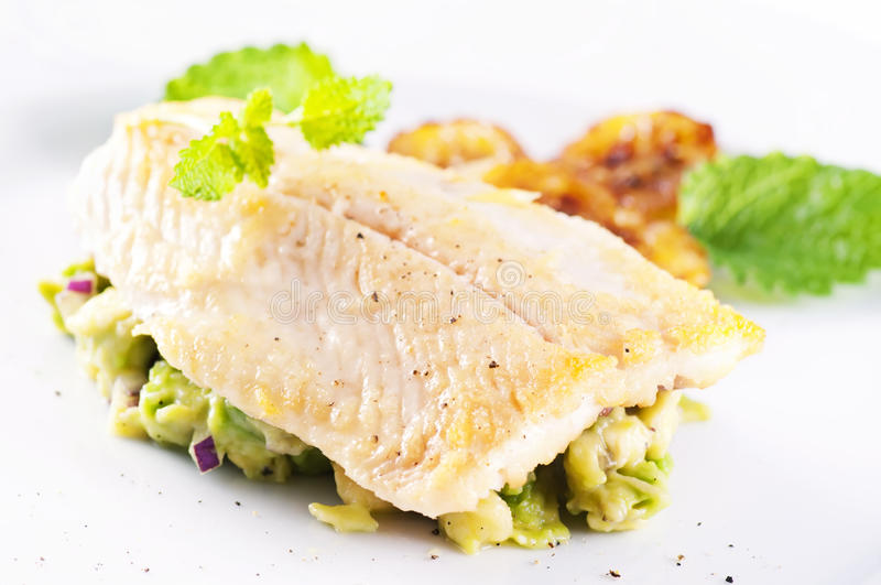 Trout fillet. Trout fried with avocado tatar royalty free stock images