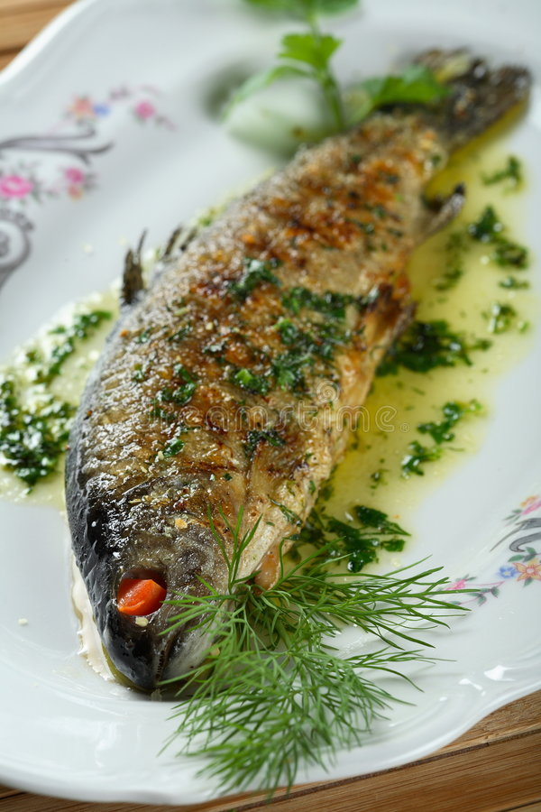 Trout with herbs royalty free stock photos