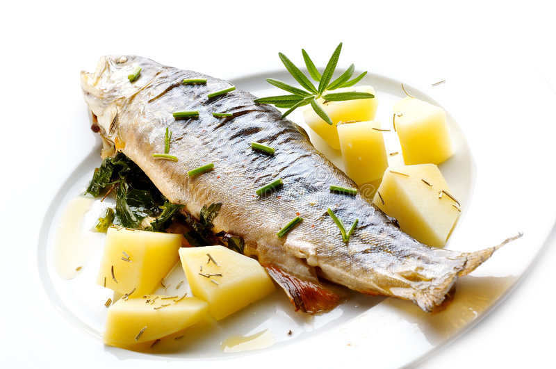 Trout with herbs royalty free stock images