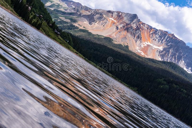 Trout Lake Colorado. Blue lake in the Colorado Rockies. Green trees and partially cloudy skies. Trout Lake Colorado royalty free stock image
