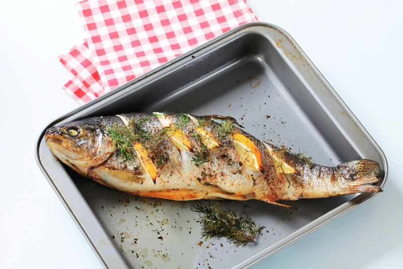 Trout with lemon and dill stock image