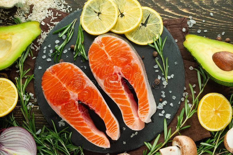 Trout, salmon, salmon fresh pieces of red fish, with vegetables. View from above, with ingredients. Background, book of chains, stock images