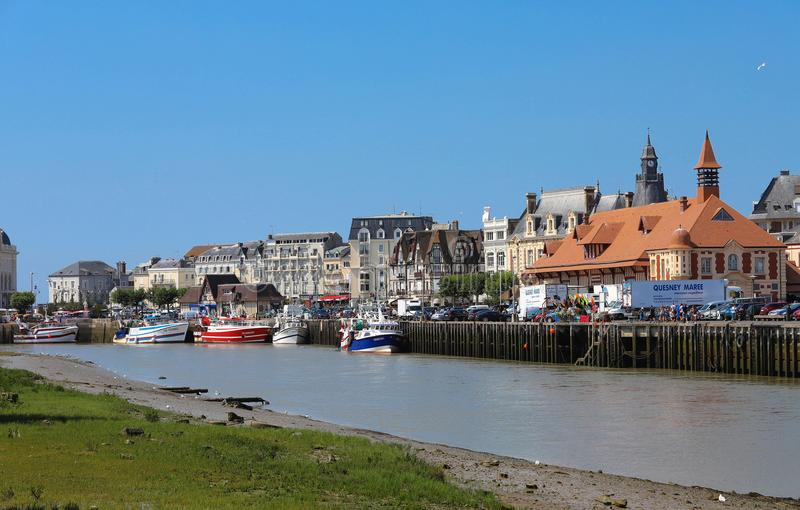 Touques River and Trouville, Normandy, France. Trouville is a village of fishermen and a popular tourist attraction in royalty free stock image