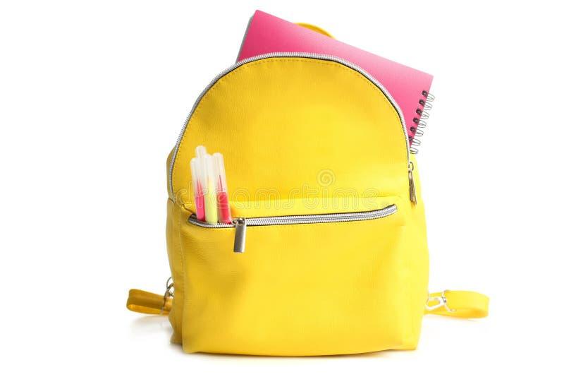 Trouxa amarela com fontes de escola diferentes foto de stock royalty free