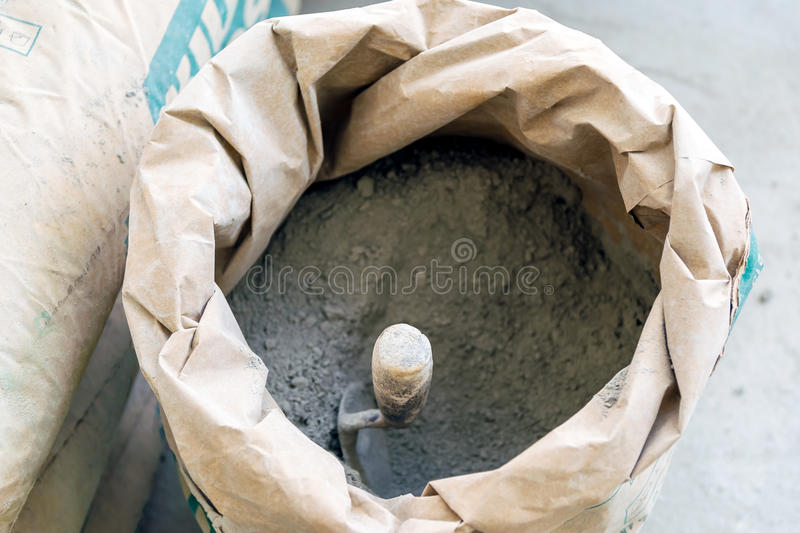 Trowel and cement powder stock photo