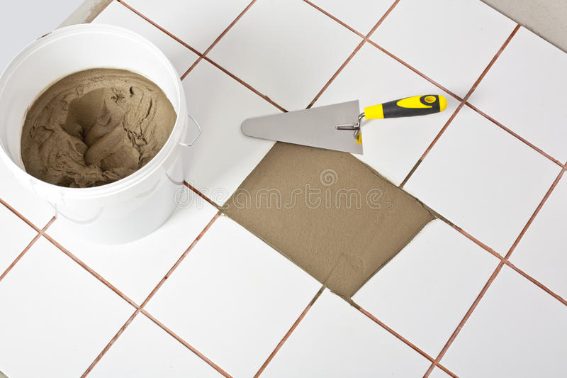 Download Trowel And Old White Tiles With Tile Adhesive Stock Photos - Image: 25670863