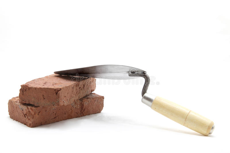 Trowel with red brick stock image