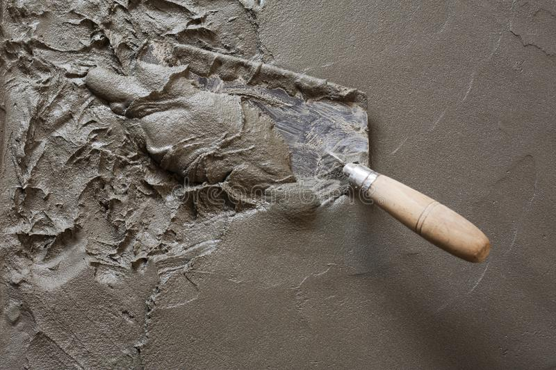 Trowel with wet concrete floor royalty free stock photography