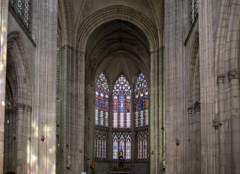 Colorful stained glass windows and altar in Basilique Saint-Urbain, 13th century gothic church in Troyes, France stock image