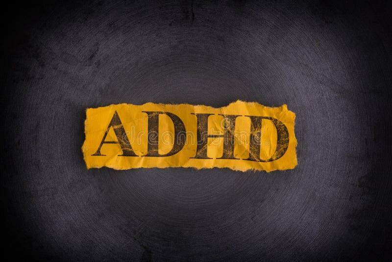 Trozo de papel rasgado con la abreviatura ADHD fotos de archivo