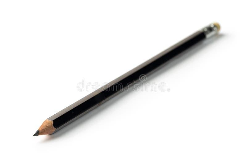 Trozo negro del lápiz en el fondo blanco imagen de archivo