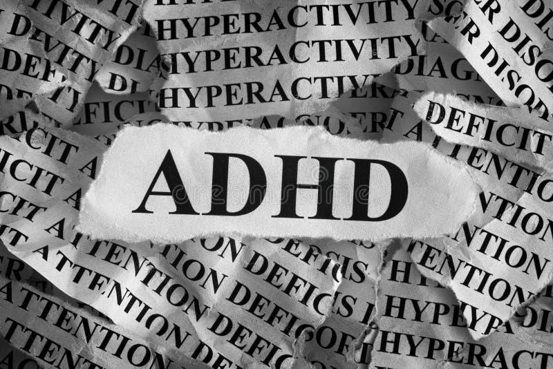 Trozos de papel rasgados con la abreviatura ADHD fotos de archivo libres de regalías