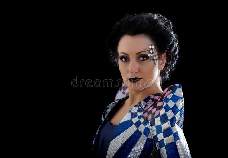 Trucco della donna di bellezza con i cristalli sul fronte fotografia stock