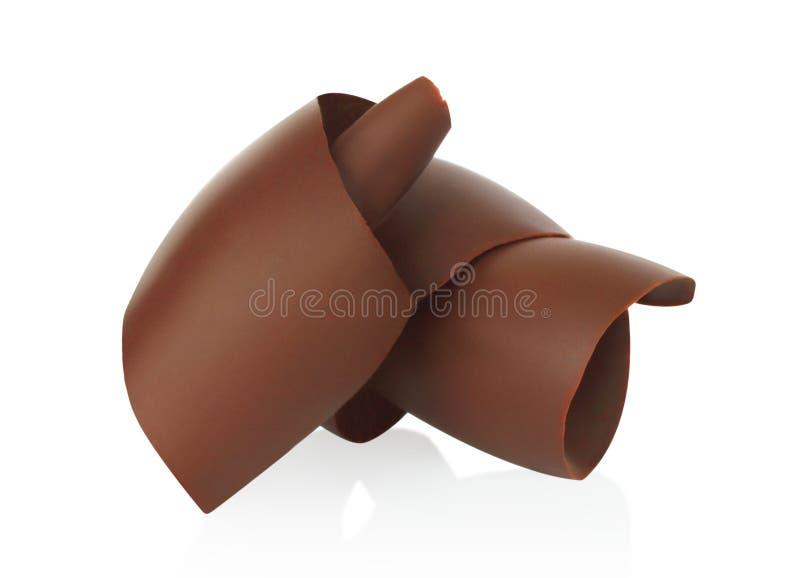 Trucioli del cioccolato su fondo bianco immagini stock libere da diritti