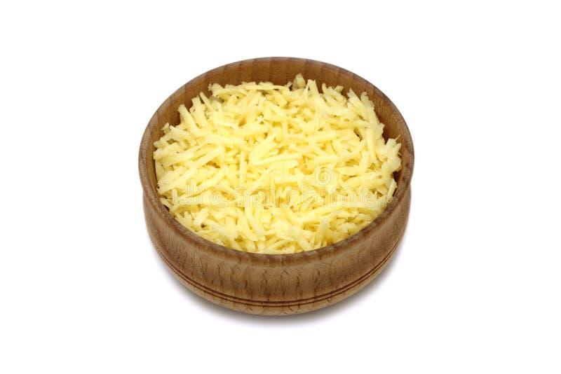 Trucioli di formaggio in ciotola di legno fotografia stock libera da diritti