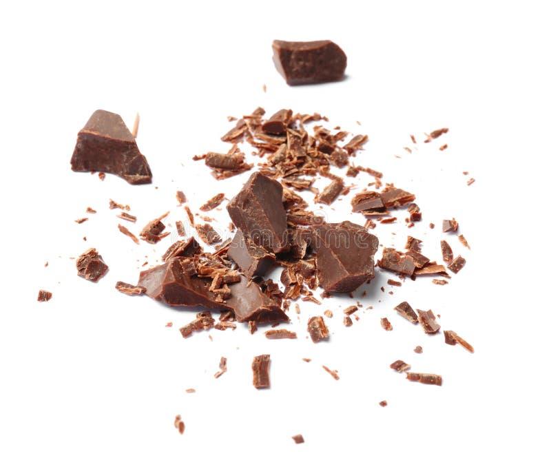 Trucioli e pezzi neri deliziosi del cioccolato fotografie stock libere da diritti