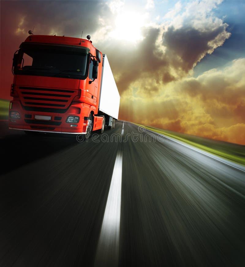 Truck. Heavy truck on blurry asphalt road under sunlight royalty free stock photos