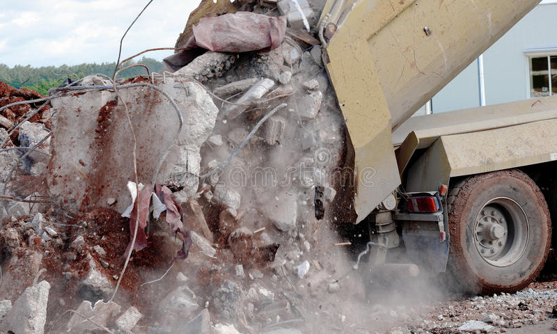 Truck. A truck is dumping rubble on site royalty free stock image
