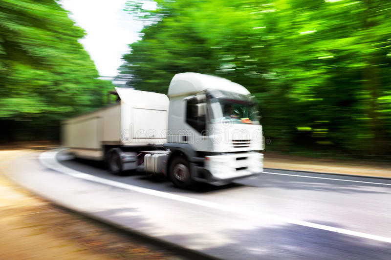 Truck in blurred motion on road. Blurred motion. Abstract background. Speed royalty free stock image