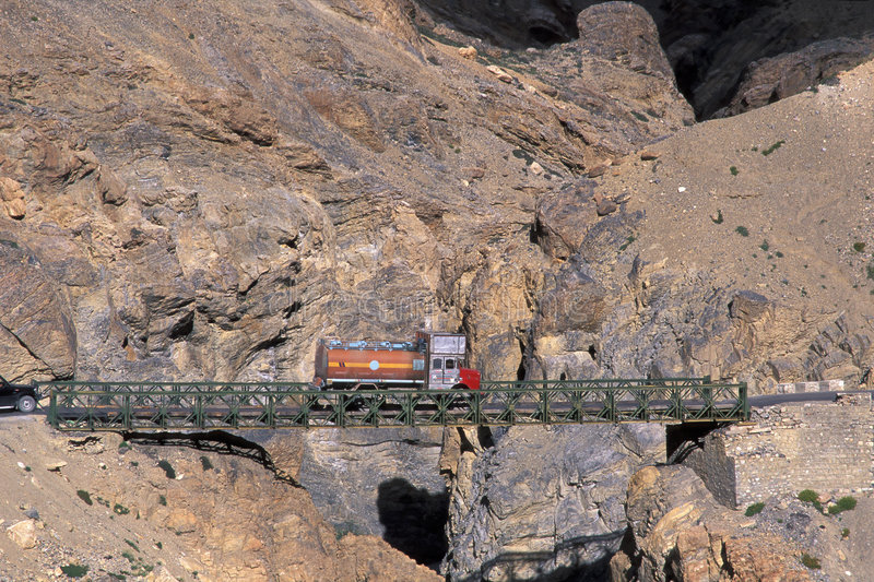 Truck on the bridge. Truck on Whisky Bridge, Zanskar Mountains, Ladakh, India royalty free stock images