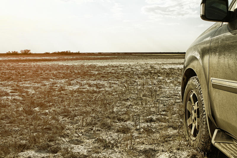 Truck car wheel on offroad steppe adventure trail royalty free stock photos