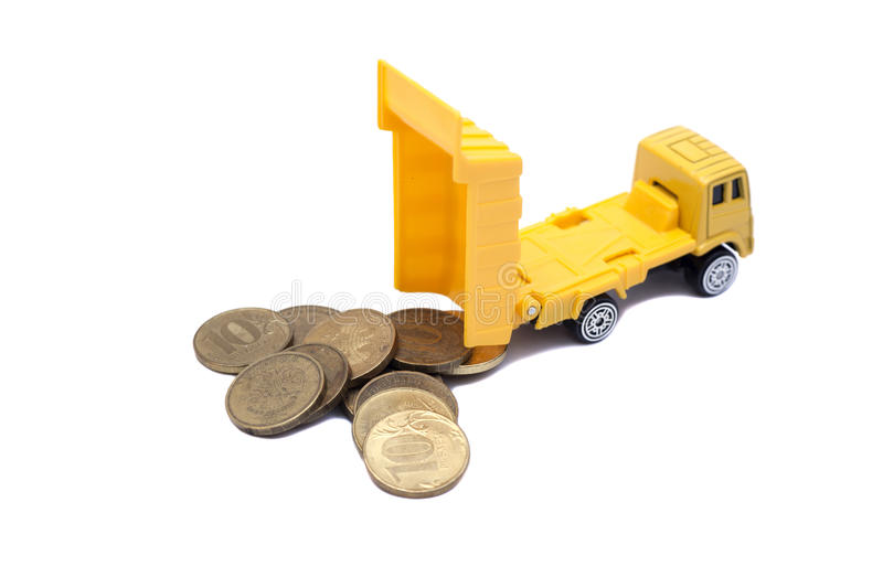 Truck caries and coins isolated on white. Background royalty free stock photography