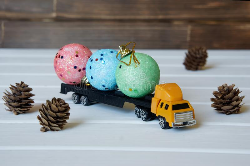 The truck carries Christmas toys for the children`s New Year stock photography