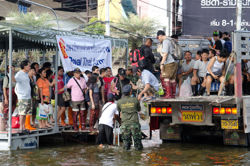 Truck carries many people to evacuate. BANGKOK THAILAND – NOVEMBER 13: Truck carries a group of people to evacuate from the flooded area at Phahon Yothin stock photo