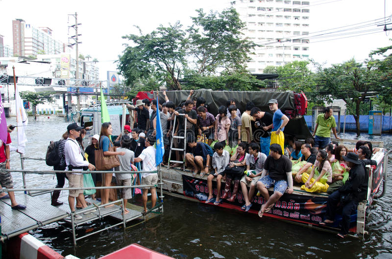 Truck carries many people to evacuate. BANGKOK THAILAND – NOVEMBER 13: Truck carries a group of people to evacuate from the flooded area at Phahon Yothin royalty free stock photos